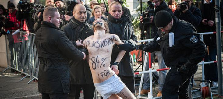 Nude protest in Berlin. Photo by R. Neugebauer
