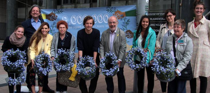 Activists handed out forget-me-not flowers to Members of the European Parliament to remind them of their duty towards the 9 million citizens who have signed a European Citizens' Initiative - MEP Josep-Maria Terricabras (Spain - Greens/EFA) stopped by to r