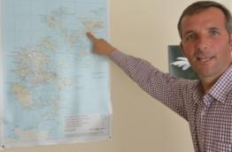 Liam McArthur points out where he lives on the Orkney Islands