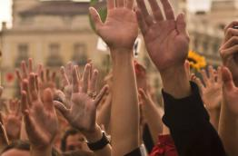 Raised hands in support for the ECI